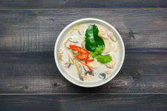 Coconut milk soup with chicken. Or Thai chicken coconut Soup ( Tom Kha Gai ) on wooden table top view, Thai local food Royalty Free Stock Photography