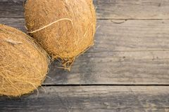 Coconuts on a rustic background. Coconut nuts, mature, on a rustic jute base on a wooden table Royalty Free Stock Photography