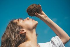 Coconut oil. coco milk. Clean eating diet, vegetarian and vegan. Woman is moisturizing her skin with a coconut cream. Drinking beach cocktail. woman drinking royalty free stock image