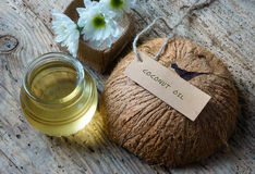 Coconut oil, essential oil, organic cosmetic. Coconut oil, essential oil from nature, a skin care that safe, rich vintamin, use in massage at spa, organic Stock Image