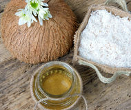 Coconut oil, essential oil, organic cosmetic. Coconut oil, essential oil from nature, a skin care that safe, rich vintamin, use in massage at spa, organic Royalty Free Stock Photo