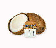 Coconut oil and fresh coconuts isolated on white Royalty Free Stock Images