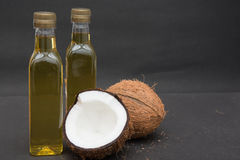 Coconut and oil isolated on black Stock Photos