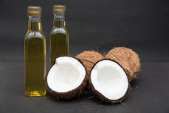 Coconut and oil isolated on black Royalty Free Stock Photography