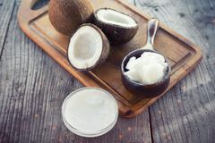 Coconut with coconut oil. In jar on wooden background Stock Photo