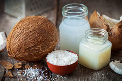 Coconut oil and milk, grounded coconut flakes and coco nut. Coconut oil and milk, grounded coconut flakes and fresh coco nut Royalty Free Stock Images