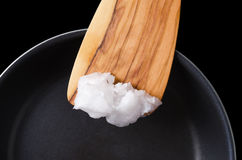 Free Coconut Oil On Wooden Spatula Over Coated Pan Royalty Free Stock Photo - 78503465