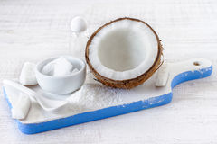 Coconut oil. Organic coconut oil in a ceramic jar on blue background. Alternative therapy Royalty Free Stock Image