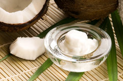 Coconut, oil and palm leaf. exotic scene Stock Photo