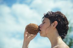 Coconut oil production. Clean eating diet, vegetarian and vegan. Woman is moisturizing her skin with a coconut cream. Drinking beach cocktail. coco milk. woman royalty free stock images