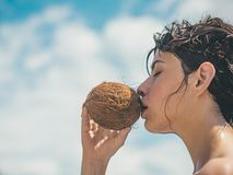 Coconut oil production. coco milk. Clean eating diet, vegetarian and vegan. Woman is moisturizing her skin with a. Coconut cream. drinking beach cocktail. woman stock photos