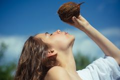 Coconut oil production. coco milk. Clean eating diet, vegetarian and vegan. Woman is moisturizing her skin with a. Coconut cream. drinking beach cocktail. woman stock photography
