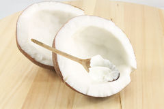 Coconut and oil on the wooden spoon Royalty Free Stock Photography