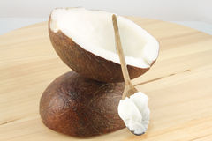 Coconut and oil on the wooden spoon Stock Images