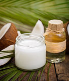 Coconut oil. On the wooden table Royalty Free Stock Image