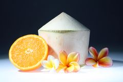 Coconut and orange with three lan thom flowers Stock Photos