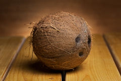 Coconut over wooden background Royalty Free Stock Images