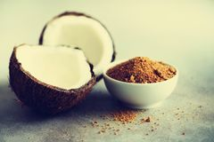 Coconut palm brown sugar and half of coconut fruit on grey concrete background. Copy space.  stock photos