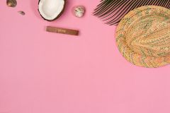 Coconut, palm leaf, hat,  on a pink background,. Top view royalty free stock image