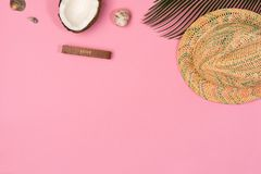 Coconut, palm leaf, hat,  on a pink background. Top view stock image