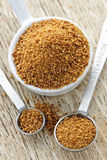 Coconut palm sugar in measuring spoons Stock Photo