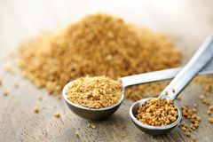Coconut palm sugar in measuring spoons. Organic coconut palm sugar in measuring spoons royalty free stock photography