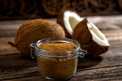 Coconut palm sugar. On rustic wooden background royalty free stock photo