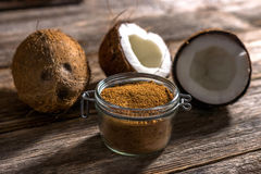 Coconut palm sugar. On rustic wooden background royalty free stock photography