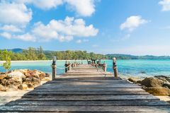 Coconut palm tree on the beach and sea. Beautiful island paradise with bridge and coconut palm tree around sea and beach on white cloud and blue sky - Holiday Stock Photos