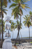 Coconut palms and statue Stock Photo