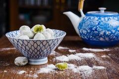 Coconut pandan ball in ceramic bowl Royalty Free Stock Photography