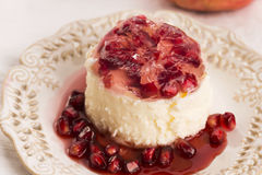 Coconut panna cotta dessert with pomegranate Stock Photos