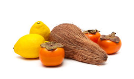 Coconut, persimmon and lemon  on a white background Royalty Free Stock Image