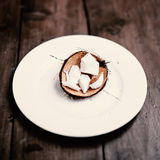 Coconut pieces on wooden background with copy space  for text Royalty Free Stock Photography