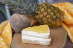 Coconut and pineapple cake with coconut and pineapple background royalty free stock image