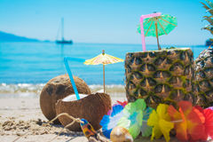Coconut and pineapple drinks by the sea Stock Image