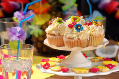 Coconut and pineapple muffins on a Hawaiian party Royalty Free Stock Images