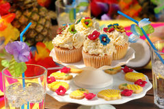 Coconut and pineapple muffins on a Hawaiian party Stock Photos