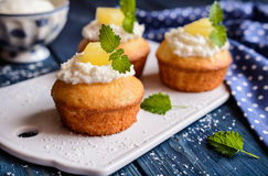 Coconut and pineapple muffins. With yoghurt topping Stock Photos