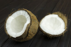 Coconut pulp fresh tropical brown white organic coconut milk on wooden black background Royalty Free Stock Photography