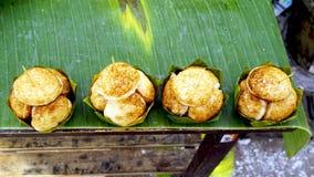Coconut Rice Cake on banana packaging Stock Photos