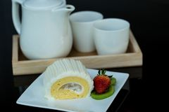 Coconut Roll Cake with tea Stock Image