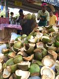 Coconut seller cutting coconut Royalty Free Stock Photography