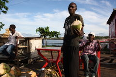 Coconut seller. Mombasa. Royalty Free Stock Photos