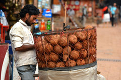 Coconut seller in the street Stock Photos