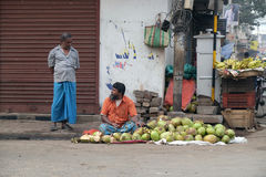Coconut seller on a street in Kolkata Royalty Free Stock Photo