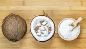 Coconut servings on Wooden Table Stock Photography