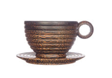 Coconut shell coffee cup with saucer on white Stock Image