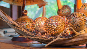 Coconut shell products. Coconut shell product, Lamp made from coconut shells stock photo