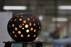 The coconut shell table lamp. The table lamp is made of the coconut shell in the south oh Stock Photography